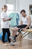 Man after knee ligament injury. In physiotherapist's office stock photos