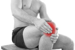 Man with knee pain. Over white background stock images