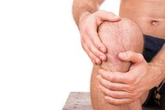 Man with knee pain. Over white background stock photos