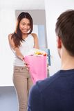 Man kneeling while giving bouquet to happy woman Stock Photography