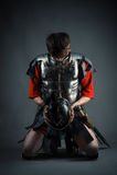 Man kneeling with a helmet in hands Stock Photo