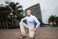 Man kneeling in a Miami scene Royalty Free Stock Photo