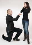 Man kneeling near woman Stock Photos