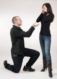Man kneeling near woman Stock Photos