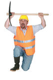 Man kneeling with pick-ax Royalty Free Stock Photo