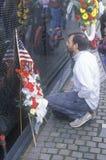 Man Kneeling at Vietnam Wall Memorial, Washington, D.C. Royalty Free Stock Photo