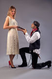 Man kneeling woman musket Stock Photography