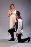 Man kneeling woman musket Royalty Free Stock Photography