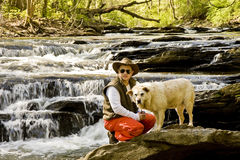Man Knelling in River with Dog Royalty Free Stock Photos