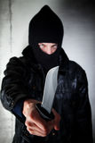 Man with knife. Young man wielding a large-bladed knife Royalty Free Stock Images