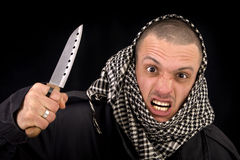 Man With Knife. With Palestinian scarf Royalty Free Stock Images