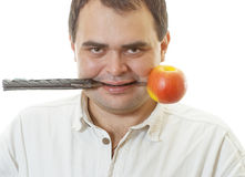 Man with knife and an apple royalty free stock photography