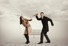 Man with knife attacking woman Stock Photography