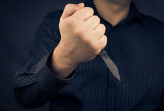Man knife hand Royalty Free Stock Images