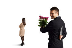 Man with knife standing behind woman Stock Photos