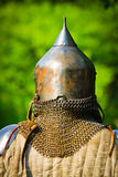 Man in knight's helmet Royalty Free Stock Photo