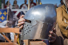 The man on the Knight Tournament holding a knight's helmet Stock Photos