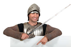 Man in knights costume Stock Images