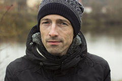 Man in a knitted cap and a black jacketr Stock Image
