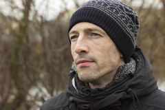 Man in a knitted cap and a black jacketr Royalty Free Stock Image