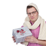 Man with knitted hat and scarf holding a gift Royalty Free Stock Photos