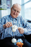 Man knitting Royalty Free Stock Photo