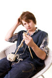 Man knitting art craft Stock Photo