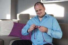 Man is knitting Stock Photos