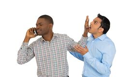 Man knocks off another guy while talking over the phone Stock Photos