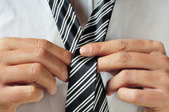 Knotting a tie Stock Image