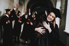 Man. Knowledge. Two Girls Hug. Happiness. Girls. royalty free stock image