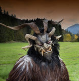 Man in Krampus costume Stock Images