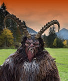 Man in Krampus costume Stock Photo