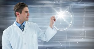 Man in lab coat with glass device against flare and motion blur Stock Image