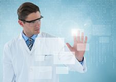 Man in lab coat and goggles with white interface and blue background. Digital composite of Man in lab coat and goggles with white interface and blue background Royalty Free Stock Images