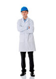 Man in a lab coat and helmet Stock Photos