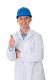 Man in a lab coat and helmet. Engineer, teacher or chemical gesturing OK Royalty Free Stock Image