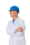 Man in a lab coat and helmet. Engineer, teacher or chemical looking on copy space Royalty Free Stock Image