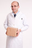 Man in lab coat holding a box Stock Photo