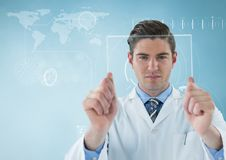 Man in lab coat holding up glass device against blue background with white interface Stock Photography