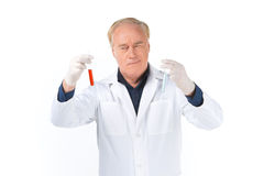 Man lab technician looks at test tubes. Royalty Free Stock Images