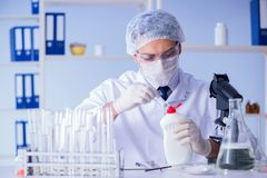 The man in the lab testing new cleaning solution detergent Stock Images