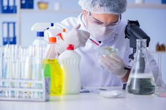 The man in the lab testing new cleaning solution detergent Stock Image