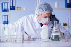 The man in the lab testing new cleaning solution detergent Stock Photos