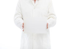 Man in labcoat holding a small poster Royalty Free Stock Photo