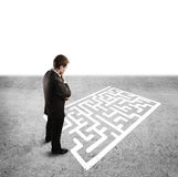 Man and labyrinth. Pensive man in front of labyrinth Stock Photography