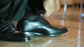 Man Lacing Shoes stock video