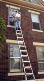 Man on Ladder Royalty Free Stock Photos