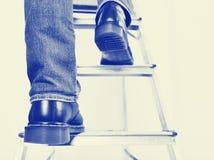 Man on ladder. Royalty Free Stock Image