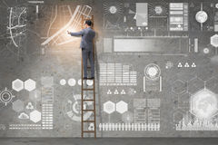 The man on the ladder in data management concept Stock Photography